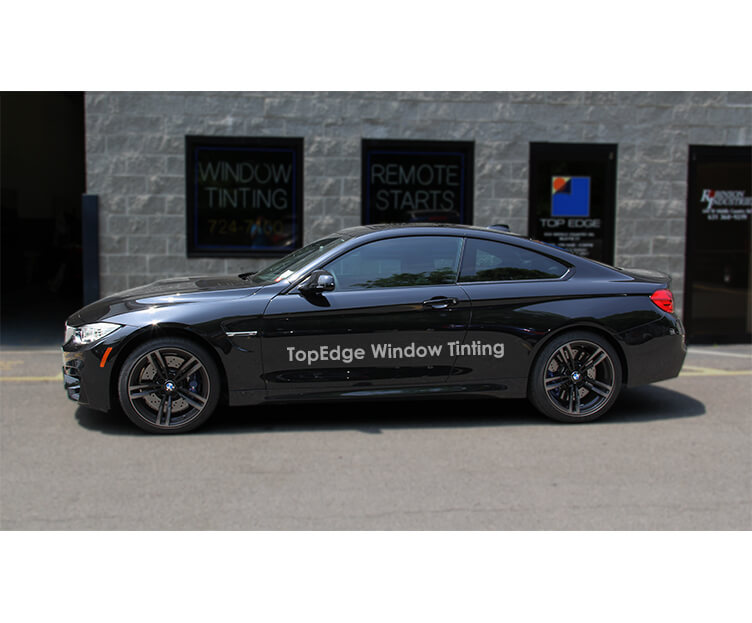 Black BMW M4 with a 40% tint