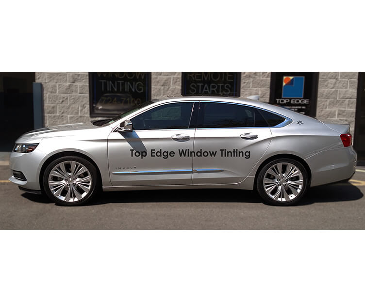Silver Chevrolet Impala with 40% tint