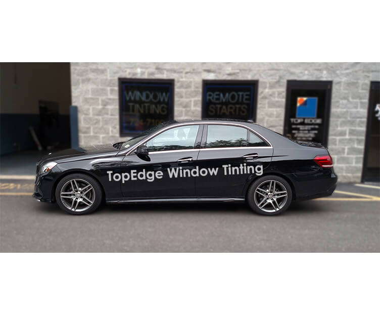 Black Mercedes Benz E-Class with 70% tint on front windows and 50% tint on rear windows