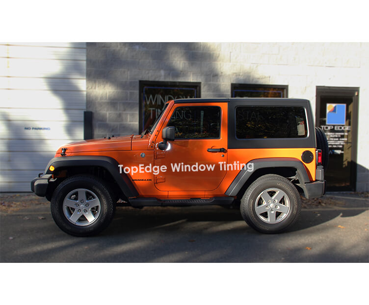 Orange Jeep Wrangler with 40% tint