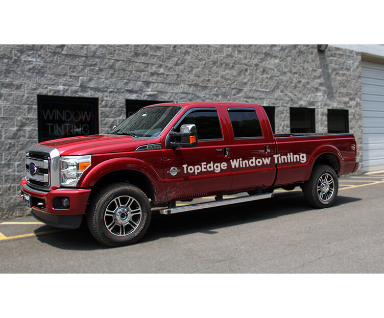 Red Ford F-250 with 20% window tint