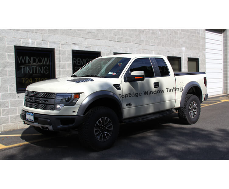 White Ford Raptor with 20% window tint