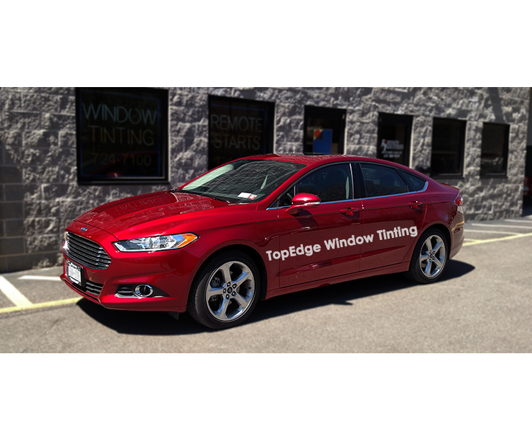 Red Ford Fusion with Carbon 45 window tint